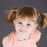 Portrait of the small smiling girl Stock Photo