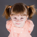 Portrait of the small smiling girl Stock Photos