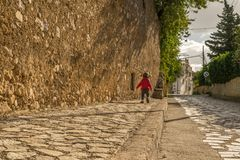 Portrait of small young child walking on a street of old town on island of Sicily stock images
