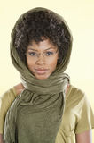 Portrait of a smart African American woman wearing glasses with stole over her head Royalty Free Stock Photo