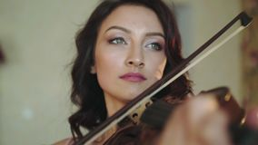 Portrait of smart, alone violinist playing the melody in bedroom stock video