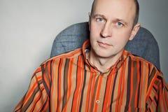 Portrait of smart bald man wearing a shirt Stock Images
