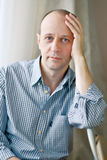 Portrait of smart bald man wearing a striped shirt Royalty Free Stock Images