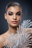 Portrait of smart beauty with silver fan Royalty Free Stock Images
