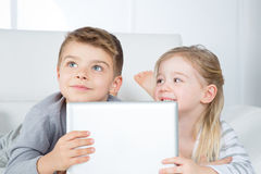 Portrait of smart brother and sister Royalty Free Stock Images