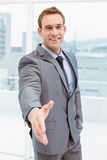 Portrait of smart businessman offering handshake Stock Photos