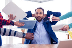 Portrait of smart businessman relaxing in office Stock Image