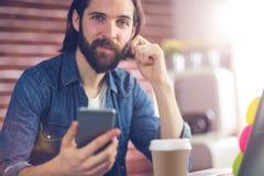 Portrait of smart businessman using cellphone Stock Image