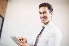 Portrait of smart businessman using digital tablet Stock Photos