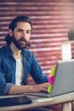 Portrait of smart businessman using laptop Stock Images