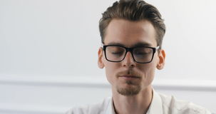 Portrait of smart casual creative young man in trendy glasses working at modern office. stock video