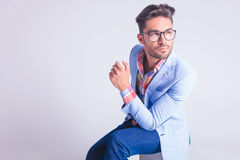 Portrait of smart casual man wearing glasses, seated Stock Photography