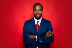 Portrait of smart clever content calm experienced well-groomed a. Ttractive handsome hr director mulatto man folded arms in suit isolated over bright vivid red stock images