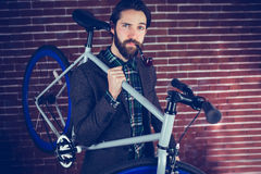 Portrait of smart confident man with bicycle smoking pipe Royalty Free Stock Photography