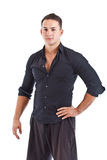 Portrait of smart guy standing with hand on hip Stock Image