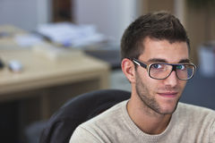 Portrait of a smart an handsome young man in office Royalty Free Stock Photo