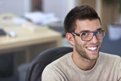 Portrait of a smart an handsome young man in office Royalty Free Stock Photos
