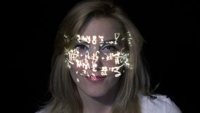Portrait of a smart intelligent blonde woman thinking how to solve integrals while math formulas are projected on her face -. Portrait of a smart intelligent stock video footage