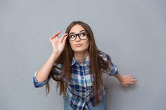Portrait of smart investigative girl in glasses Royalty Free Stock Photo