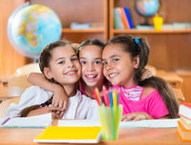 Portrait of smart schoolchildren in classroom Stock Photo