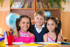 Portrait of smart schoolchildren in classroom Stock Photos