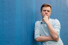 Portrait of a smart serious young man Stock Photos