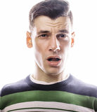 Portrait of a smart serious young man standing against white background. Emotional concept for gesture Royalty Free Stock Images