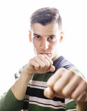Portrait of a smart serious young man standing against white background. Emotional concept for gesture Stock Photo