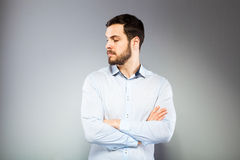 Portrait of a smart serious young man standing Royalty Free Stock Photo