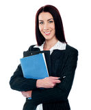 Portrait of smart smiling secretary holding file Royalty Free Stock Photography