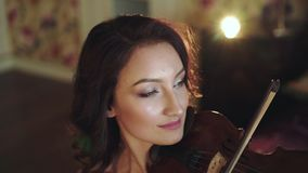 Portrait of smart violinist playing the melody in bedroom stock video