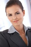 Portrait of smart woman smiling Stock Photo