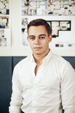 Portrait of a smart young man standing with arms crossed Royalty Free Stock Photo