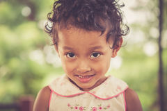 Portrait of smile asian poor girl royalty free stock photography