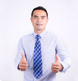 Portrait of smile asian Thai business man showing double thumb u Stock Images