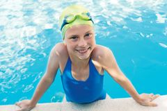 Portrait of smile little cute child in the swimming pool. Portrait of little cute child in the swimming pool.Focussed athlete before the start royalty free stock photo