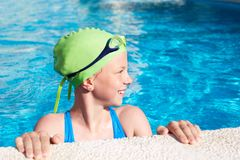 Portrait of smile little cute child in the swimming pool. Portrait of little cute child in the swimming pool.Focussed athlete before the start Stock Photo