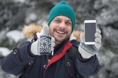 Portrait of smile man who holding smart phone and thumb up. Holiday concept stock photo