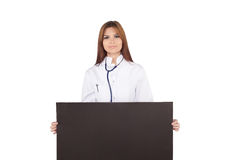 Portrait of smiley female doctor,holding black card Royalty Free Stock Photography