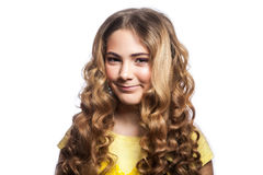 Portrait of smiley girl with wavy hairstyle and yellow t shirt. Studio shot isolated on white background Royalty Free Stock Image