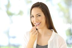 Smiley woman taking a pill looking at you Stock Image