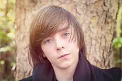 Portrait of a smiliing teenage boy. Closeup portrait of a smiliing teenage boy Royalty Free Stock Photos
