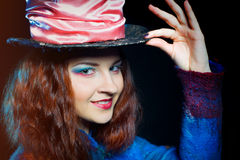 Portrait of smilimg young woman in the similitude of the Hatter. Portrait of young woman in the similitude of the Hatter (Alice's Adventures in Wonderland royalty free stock photo