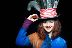 Portrait of smilimg young woman in the similitude of the Hatter royalty free stock photos