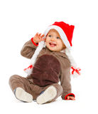 Portrait of smiling adorable baby in Santa hat Stock Photo