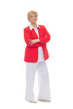 Portrait of a smiling adult woman in a red jacket stock images