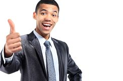 Portrait of a smiling African American business man gesturing a thumbs up sign. On white background Royalty Free Stock Photography