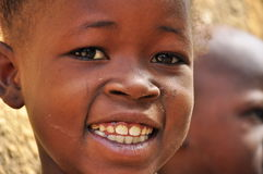 Portrait of  smiling african little girl. Face of beautiful african little girl with lovely eyes and great smile, west Africa Stock Images
