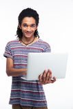 Portrait of a smiling afro american man using laptop Stock Photos