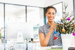 Portrait of smiling afro-american office worker decorating christmas tree in offfice Royalty Free Stock Photo
